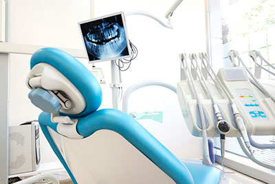 Comfortable dental chair in bright operatory